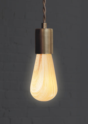 Wood Light Bulb in Pine for Scandinavian decor turned on