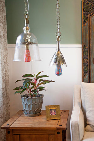 Floral and geometric light bulbs in decorative ceiling fixtures over end table