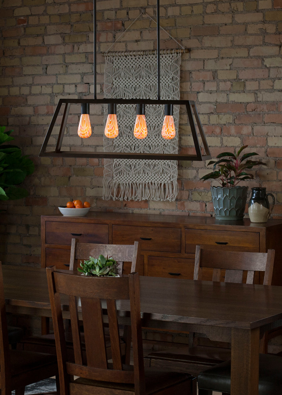 Geometric light bulbs ceiling fixture provides lighting for elegant dining room