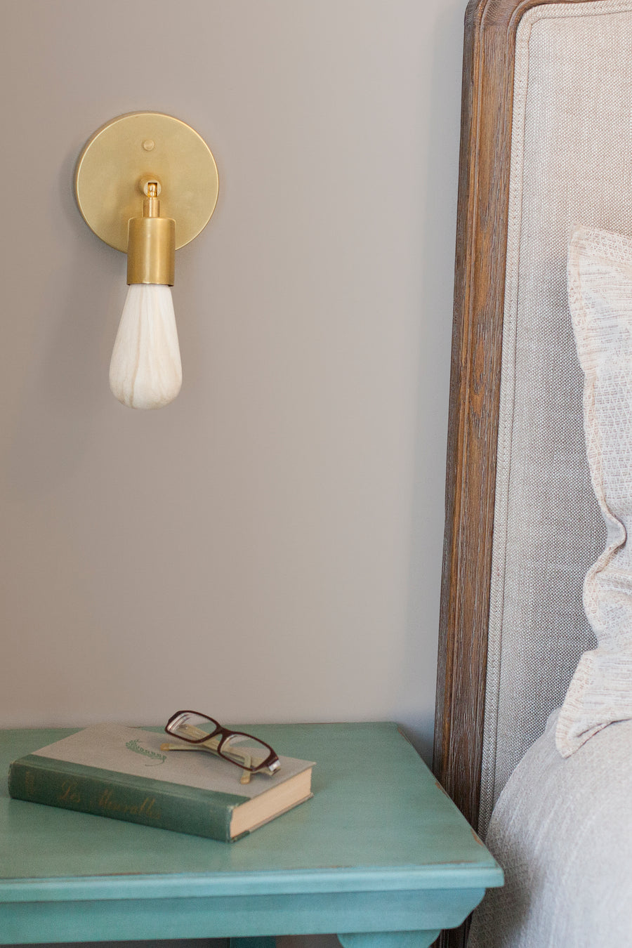 Light marble light bulb featured in stylish bedroom