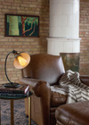 Printed pine wood light bulb in table lamp near exposed brick