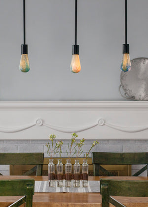 Space light bulb with stars in stylish dining room