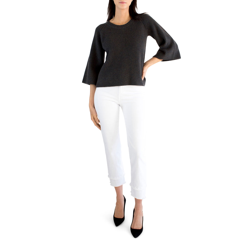 With a slight bell-sleeve and a crop silhouette, the Candor Pullover pairs great with all those high-waisted jeans you have laying around. Perfect for a winter's night out on the town.   100% Cashmere Model is 5'8 and is wearing a size S Imported