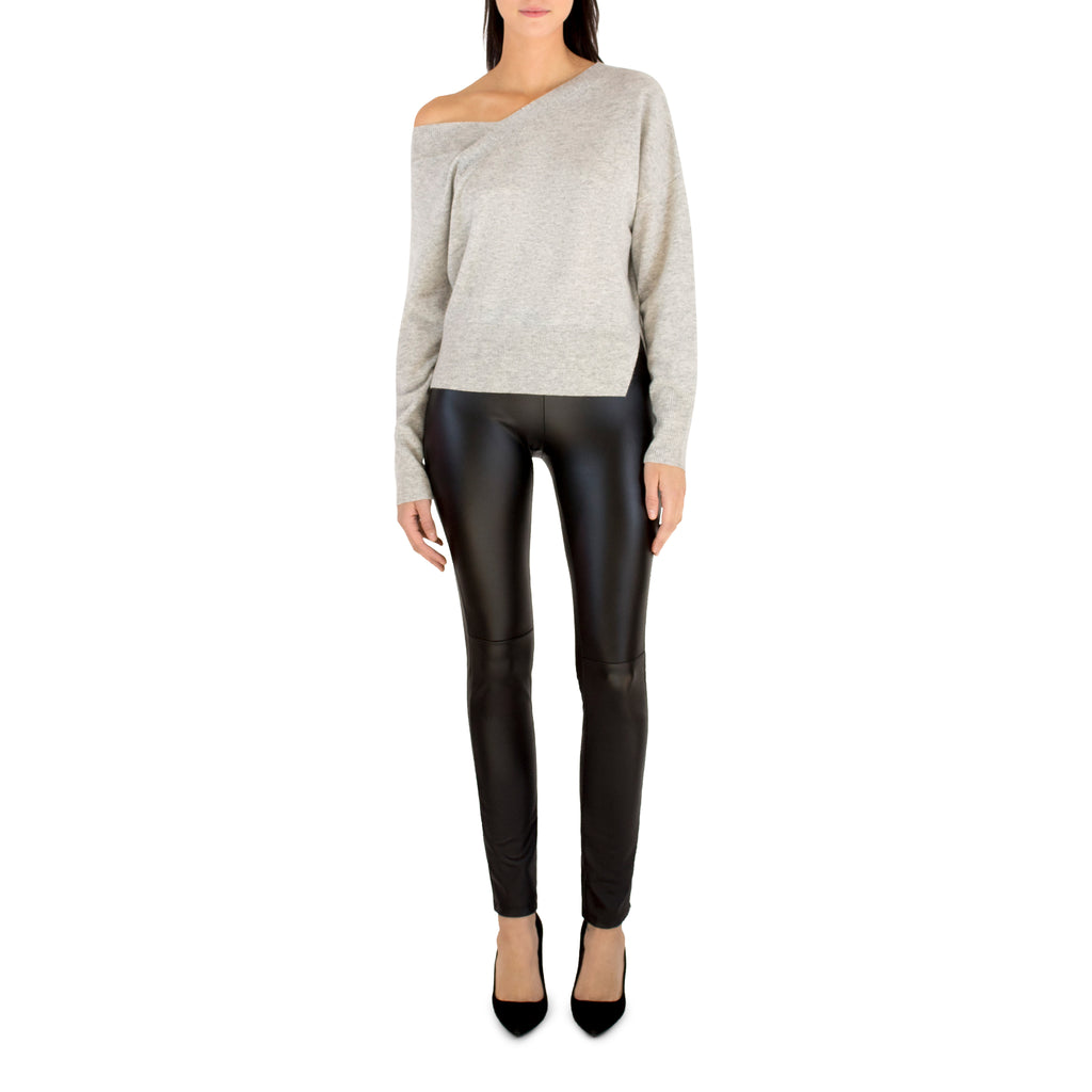 Our new favorite design from Brochu Walker, the Reed Pullover mixes style with comfort perfectly. The long asymmetrical back pairs perfectly with leather leggings and a pump. Buy your true size.   70% Wool 30% Cashmere Model is 5'8 and is wearing a size S Imported