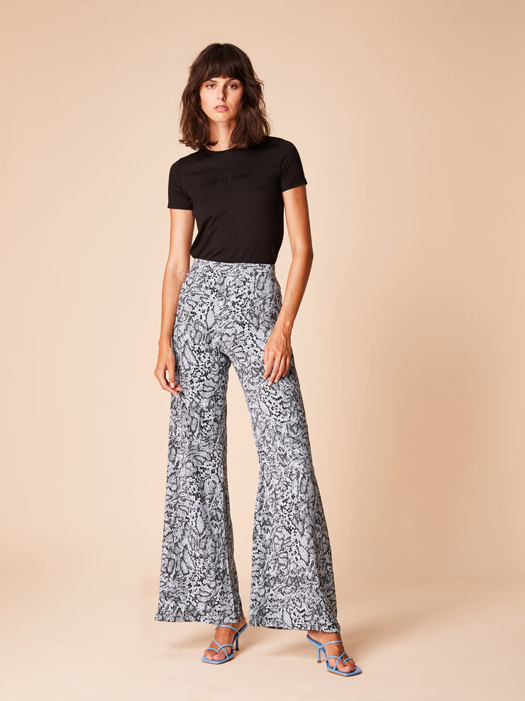 She Is Rebel - She Is Rebel Slim Fit Black Tencel Logo T-shirt & Frida Blue Snake Print Wide Leg Pants - Shop Stylish Sustainable Women's Tops