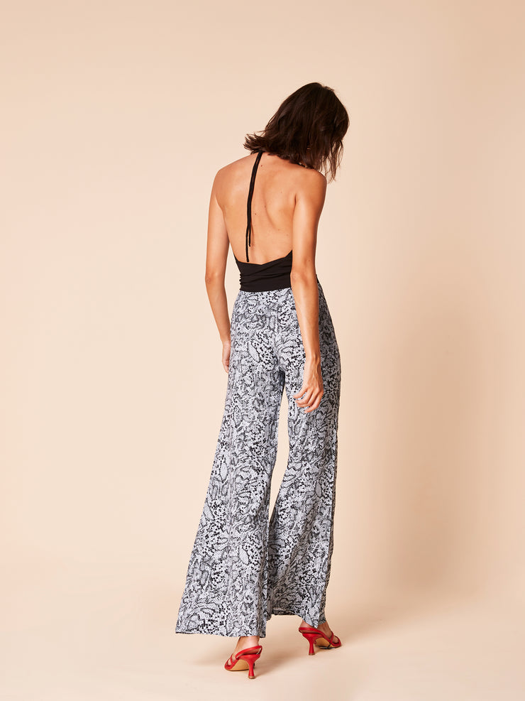 She Is Rebel - Cahide Black Halter Neck Open Back Top & Frida Blue Snake Print Wide Leg Pants - Shop Stylish Sustainable Women's Tops