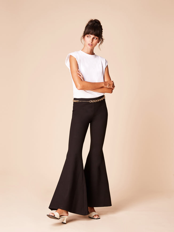 She Is Rebel - Gabrielle Mid Rise Black Extra Wide Flare Pants & Sabiha White Organic Cotton Padded Shoulder T-shirt - Shop Stylish Sustainable Women's Pants