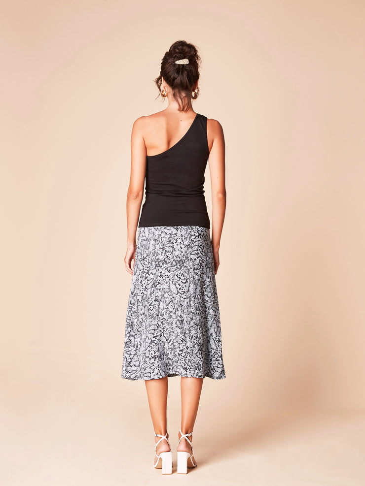 She Is Rebel - Wangari Black One Shoulder Organic Cotton Top & Virginia Midi Blue Snake Print Skirt - Shop Stylish Sustainable Women's Tops