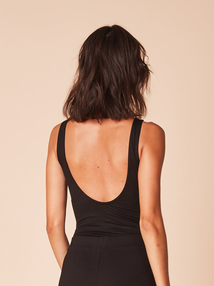 She Is Rebel - Whitney Black Sleeveless Open Back Tencel Bodysuit & Gabrielle Black Extra Flare Wide Leg Pants - Shop Stylish Sustainable Women's Tops