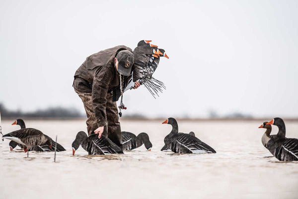 Grand Prairie authority Brent Birch placing specklebelly silhouettes in a flooded field.