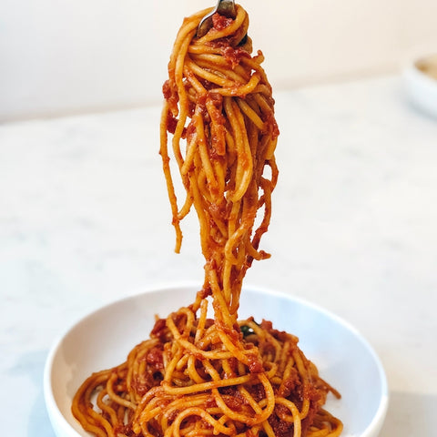 spaghetti all'amatriciana on fork