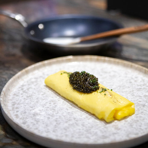 omelette with caviar next to non stick frying pan