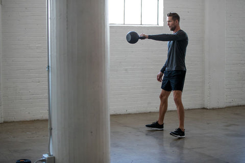 man working out in workout shorts