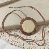 Rose gold and cream pendant necklace