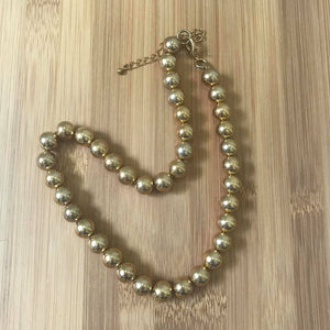 Large gold bead necklace