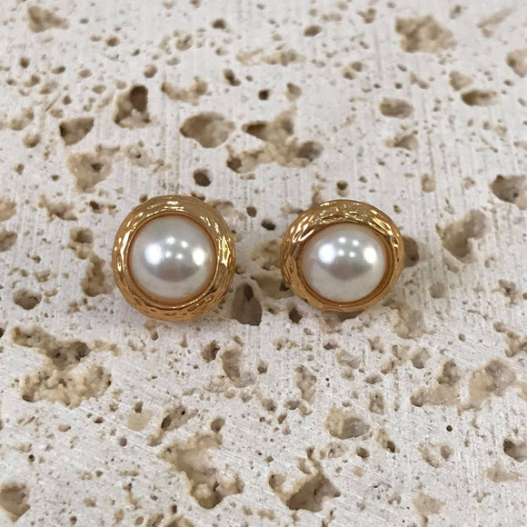 Pearl on gold studs