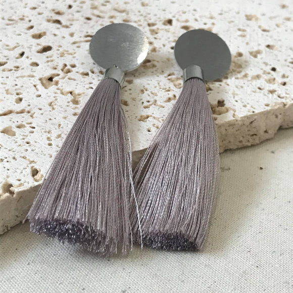 Silver tassel and stud earrings