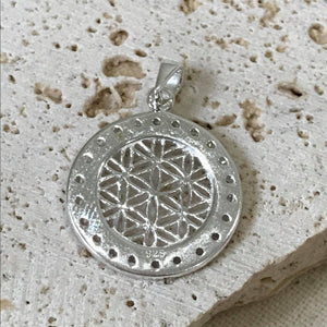 Patterned circle pendant