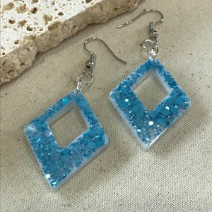 Sky blue glitter triangle drop earrings