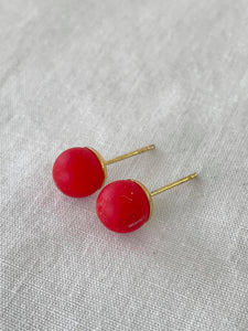 Solid red studs