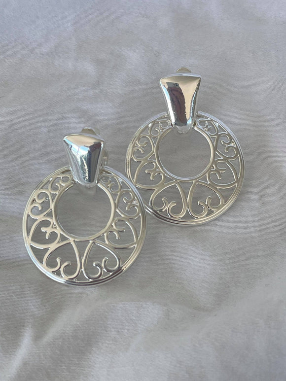 Large silver circle with hollow heart clip on earrings