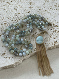 Grey beaded necklace with long gold chain strands