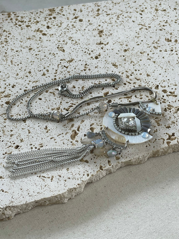 Multiple grey chains with stunning pendant