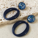 Blue resin ovals with glitter earrings