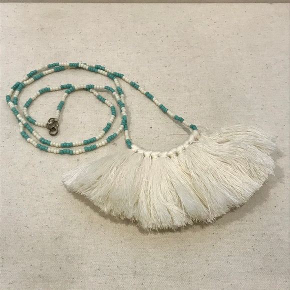 White tassel with green bead necklace