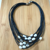 Pearls on leather strands necklace