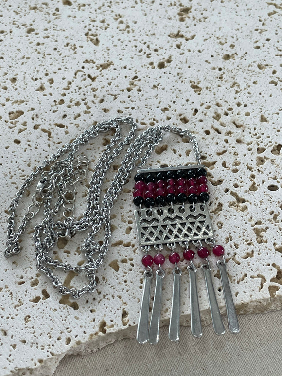 Red and black beads pendant on long silver necklace