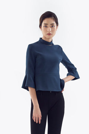 blue mock neck top with flared sleeves