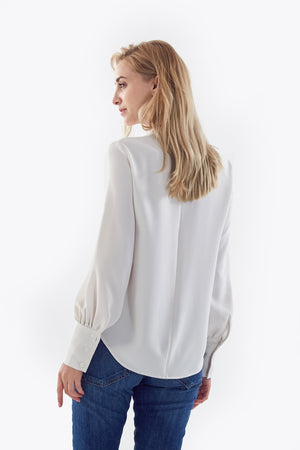 white blouse with flared sleeves