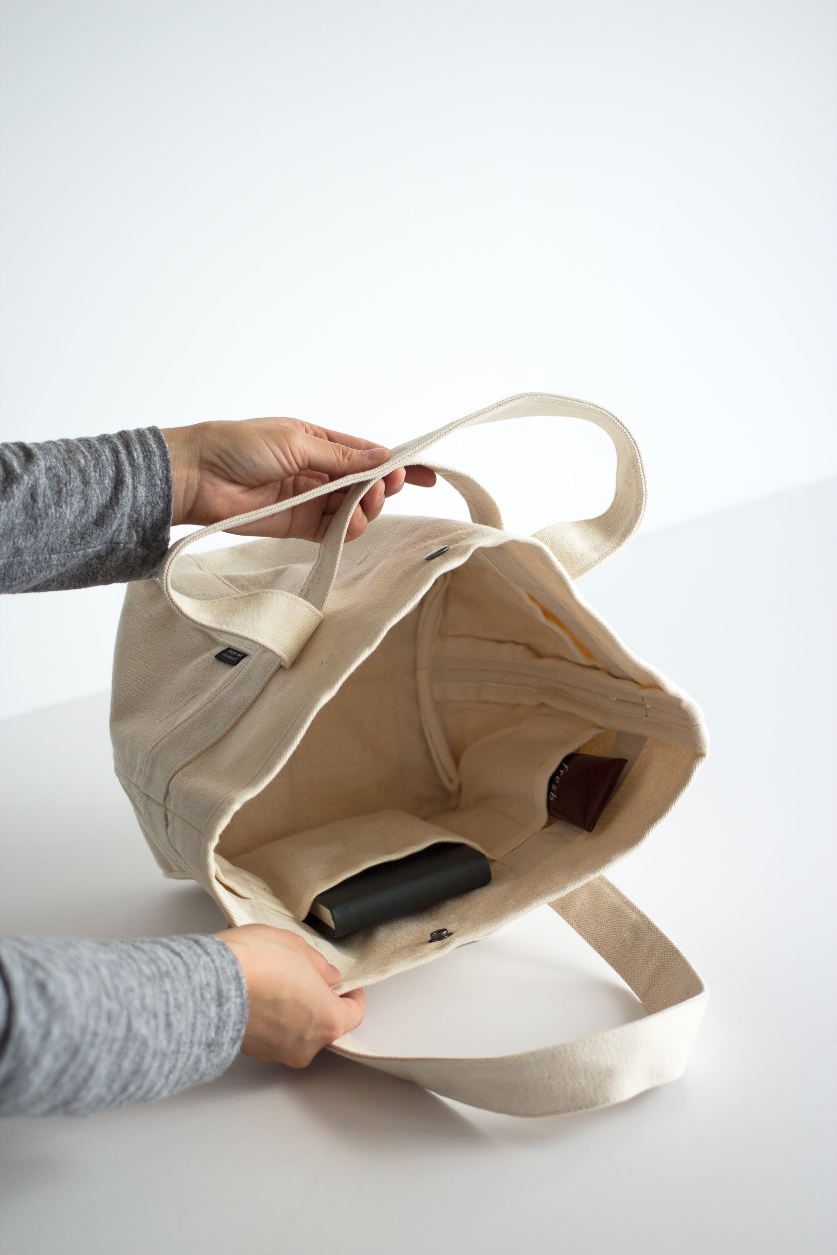 Showing built-in pockets are used to organize the Day Tote