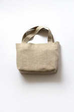Load image into Gallery viewer, front view of revered bag. two built in pockets inside