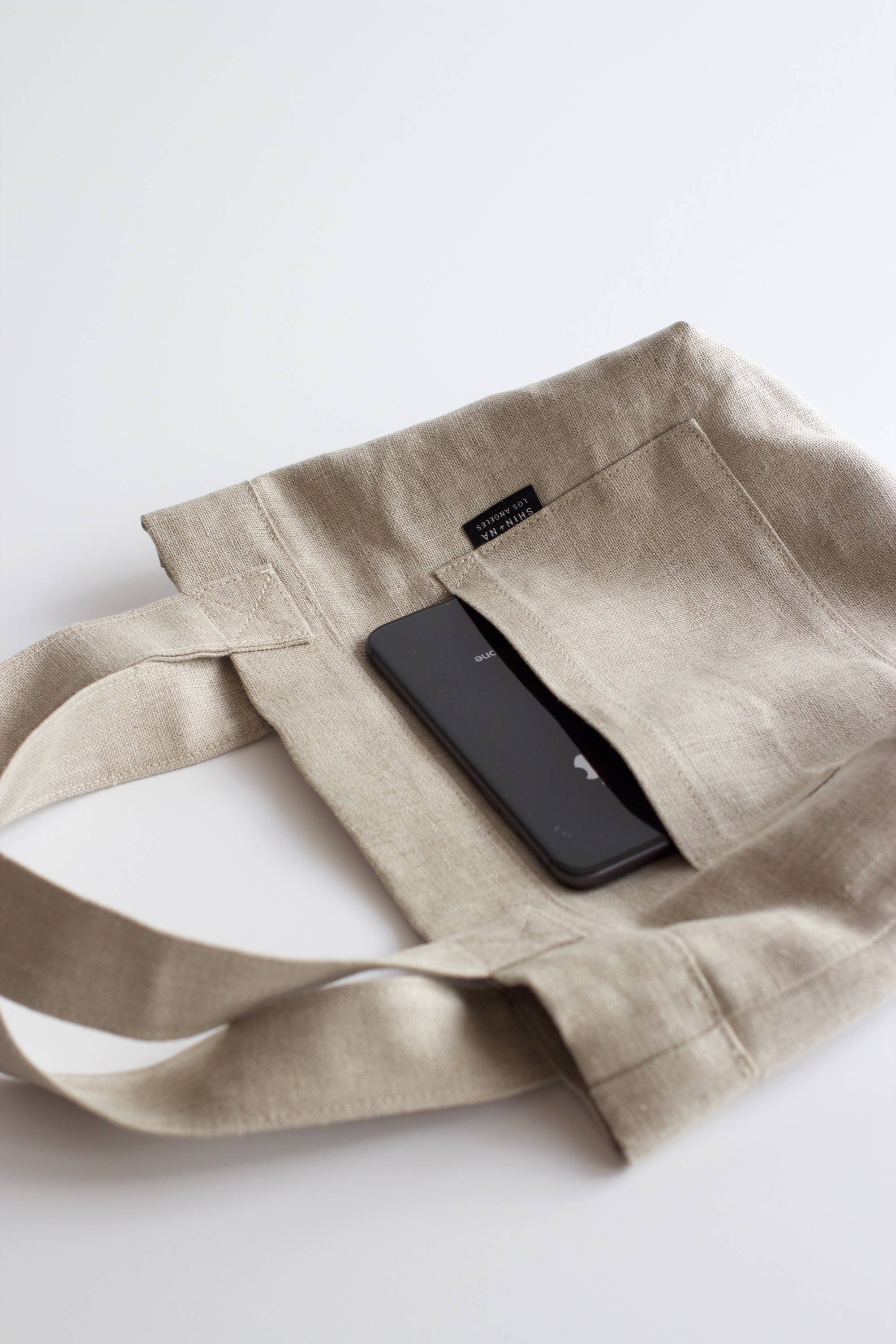 Four by seven inch pockets fits a cell phone