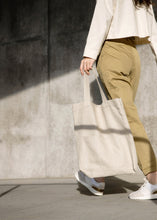 Load image into Gallery viewer, Model holding the Mitaka large bag