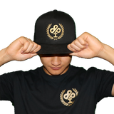 GOLD 1 Mil Royal IBP logo on Black Snapback Trucker Hat