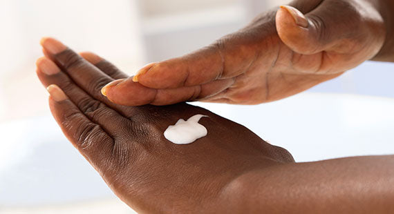 Female hand applying moisturiser picture