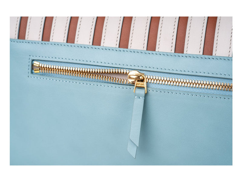 Fine hardware and detail of fan crossbody bag