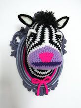 Crochet zebra head in a purple frame.