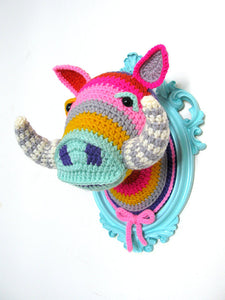 Crochet boar head in a light turquoise frame.