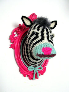 Crochet zebra head in a hot pink frame.