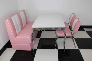 Pink Booth, 2 Chairs and White Four Legged Table