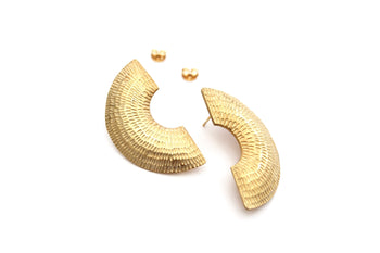 View and buy handmade jewellery by Caitlin Hegney at The Biscuit Factory. Image shows two large c-shaped gold studs with linear markings