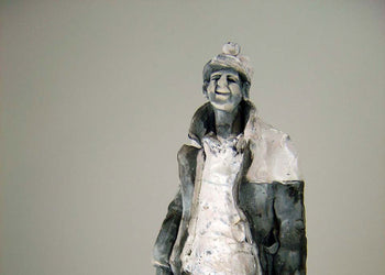 View and buy original sculpture by Alistair Brooks at The Biscuit Factory. Image shows a sculpted miner in charcoals, greys and whites with a large coat and miner's lamplight helmet.