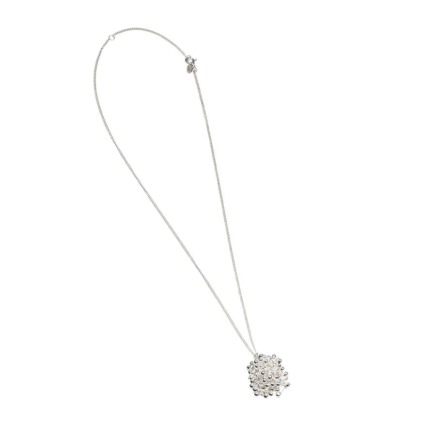 Buy 'Innocence Drop Necklace', silver necklace by Yen. Image shows a silver chain necklace with a large cluster of small silver balls creating a pendant. The necklace sits on a white background.