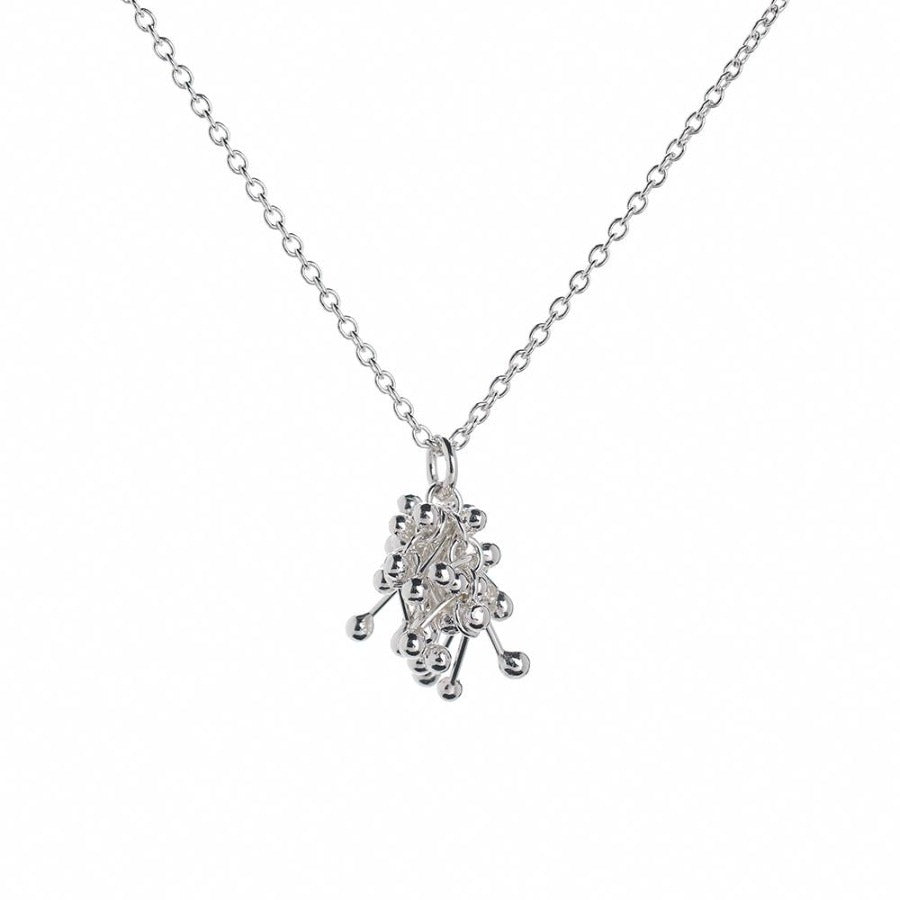 Buy 'Molecule Joy Cluster Necklace', silver pendant necklace by Yen. Image shows a silver pendant on a silver chain sat on a white background. The pendant is a cluster of silver bars with balls at either end hooked together.