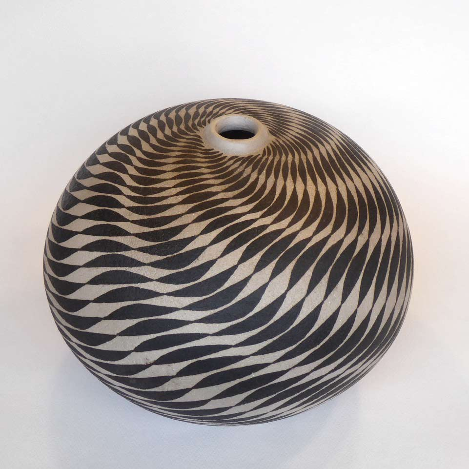 Buy 'Black Waves' a large ceramic vessel by Ilona Sulikova. Image shows a spherical ceramic pot with a very narrow lipped opening at the top decorated with a meticulous black spiraling wave pattern - the pot is sat on a white background.
