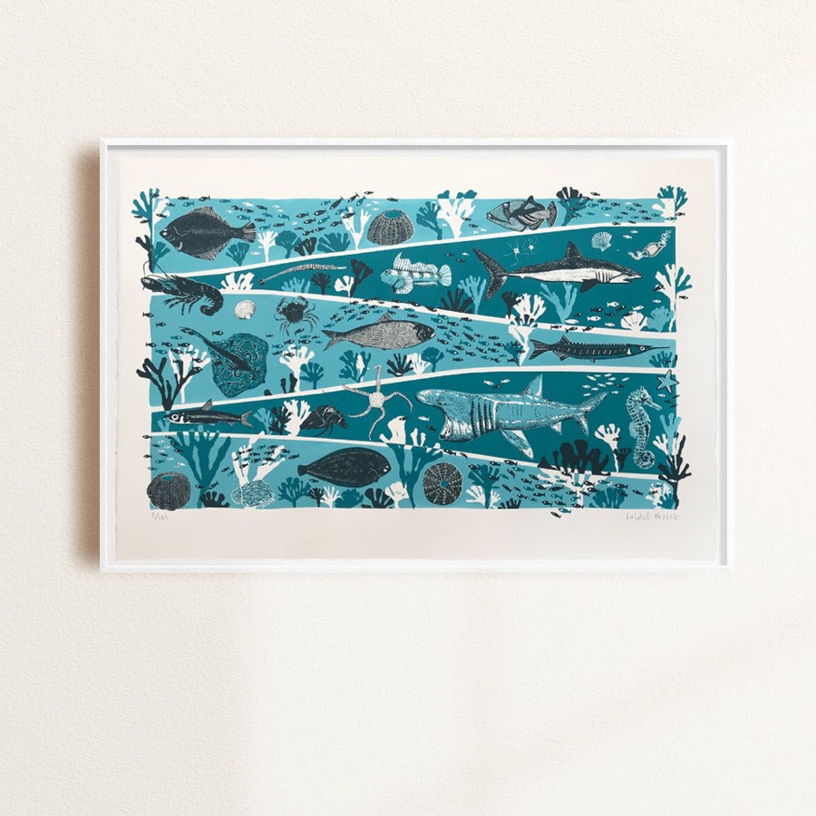 Buy 'Sea' an animal screen print by Folded Forest. Image shows a blue, navy and white screen print of a layered seabed with different animals featured on each tier. The print is displayed in a white frame hanging on a white wall.